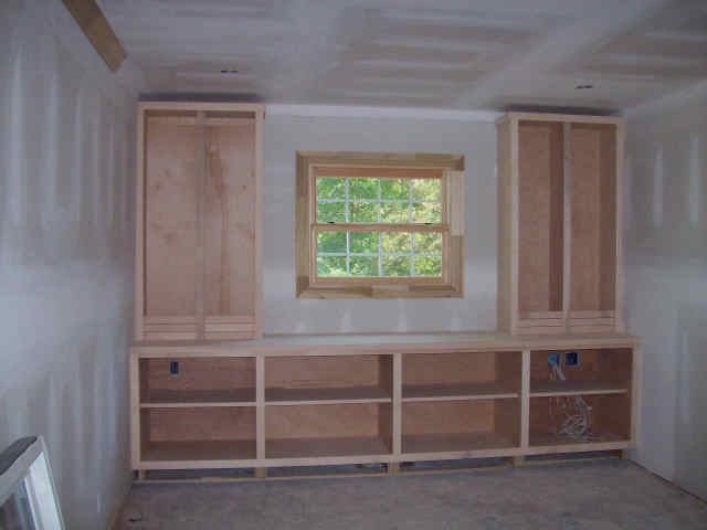 After drywall come the built-in cabinets